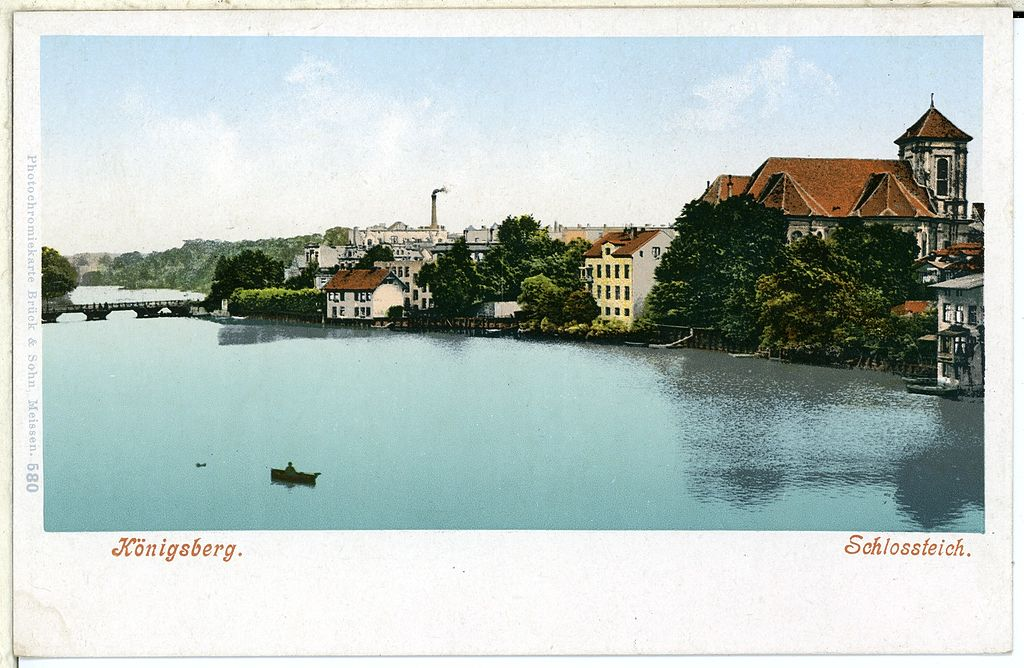 Postcard of buildings by a river. Caption reads 'Königsberg Schlossteich'